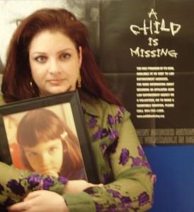 "Melissa ""Liss"" Haviv holds a photo of Missy Sokolsky"